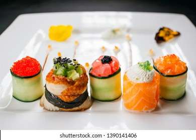 Sushi rolls degustation, fusion food style restaurant menu, deluxe gastronomy. Set of finest seafood snacks on white plate