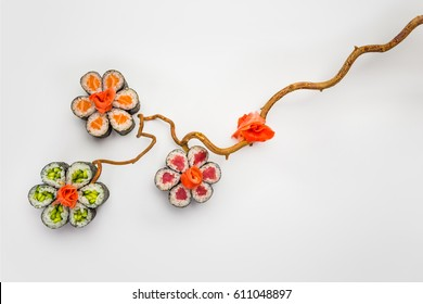 Sushi rolls as a flower over neutral background. Japanese cuisine. Japanese style.