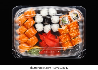 sushi rolls mix in a plastic box container