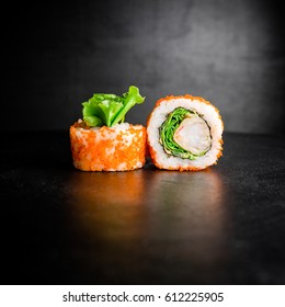 Sushi rolls on a black background. Japanese food