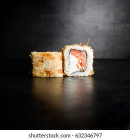 Sushi rolls on black background. Traditional food.