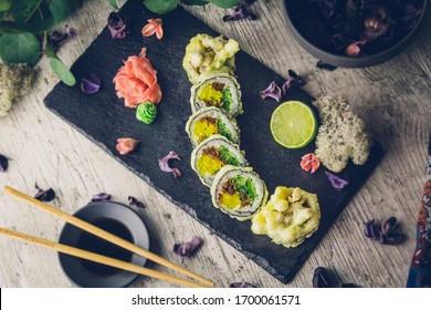 Sushi rolls on a blackboard