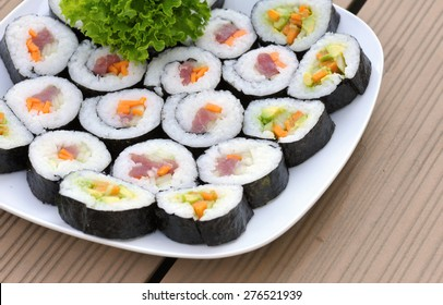 Sushi rolls on a plate from above
