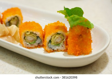 sushi rolls on white plate Japanese food