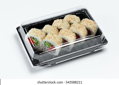 sushi rolls in plasticcontainer close up  isolated on a white background. Sushi take away in plastic box