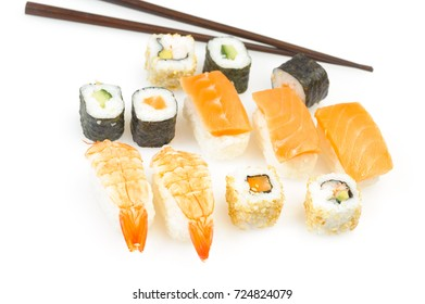 Sushi and rolls in a plate with sticks isolated on a white background.