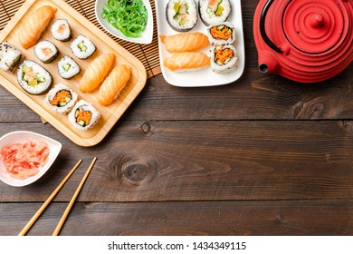 Sushi rolls and sashimi served on bamboo plate