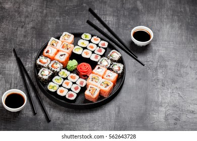 Sushi rolls set served in round plate, selective focus