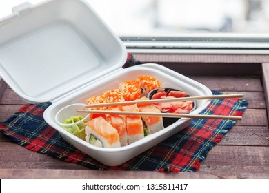 sushi rolls in takeaway container