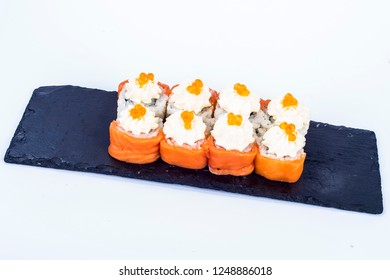 sushi with salmon and caviar, philadelphia cheese, lay on a plate