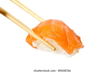 Sushi with salmon fish in chopsticks, isolated on white