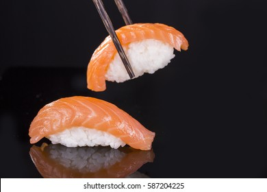 Sushi with a salmon on a black background / sushi with salmon on a black background / Nadale