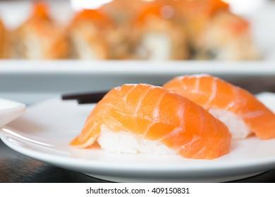 Sushi salmon on white plate