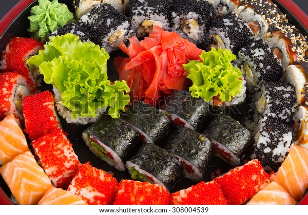 Sushi with salmon red caviar and vegetarian roll. Sushi set.