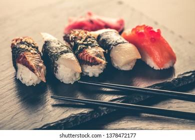 sushi set and chopsticks on a stone board
