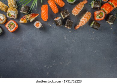 Sushi set with chopsticks. Various delicious japanese sushi, roll pieces and nigiri on light blue background
