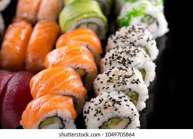 sushi set close up on black background
