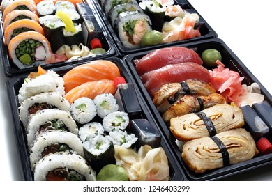 Sushi set. Composition of trays with sushi rolls on a white background.
