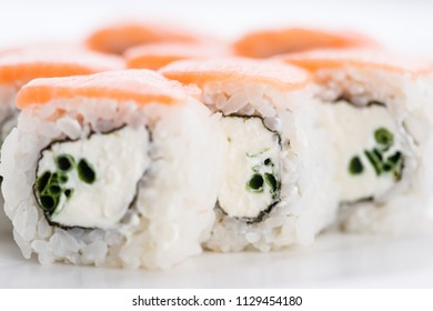 Sushi set and composition at white background. Japanese food restaurant, sushi maki gunkan roll plate or platter set.