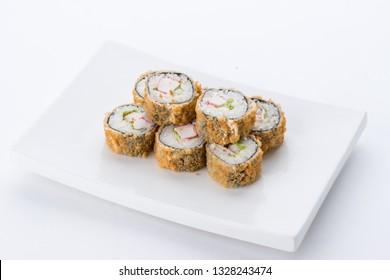 Sushi set and composition at white background. Japanese food restaurant, sushi maki gunkan roll plate or platter set.
