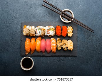 Sushi set. Sushi maki, gunkan and sushi rolls served on stone slate. Japanese food