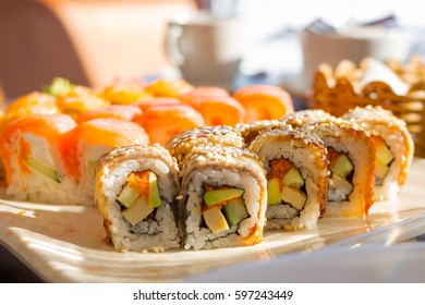 sushi. Sushi Set: sushi rolls on  plate selective focus. sunny day in restaurant