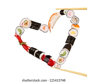 Sushi sticks holding pieces of sushi in heart shape, isolated on white background