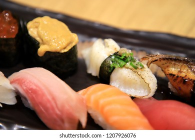 Sushi is a traditional food from Japan by  prepared vinegared rice with some sugar and salt, combined with a variety of ingredients like fresh seafood. It is a popular dish in other countries as well.