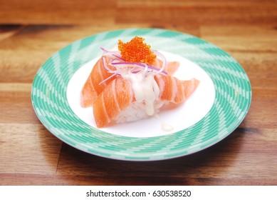 sushi train - salmon sushi on top raw fish egg