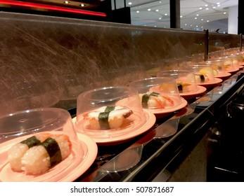 Sushi tray on conveyor belt in restaurant