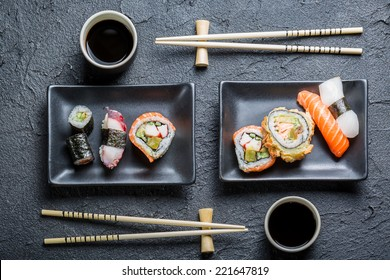 Sushi for two served on black stone