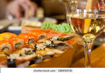 Sushi and white wine on the table