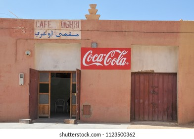Sus-Masa-Draa, Morocco - march 20, 2012: Facade of a bar with famous soda ad on the street of a small village in the Zagora region