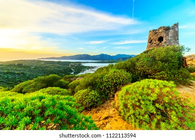 Susnet over old tower with a panoramic view of Villasimius, Sardinia