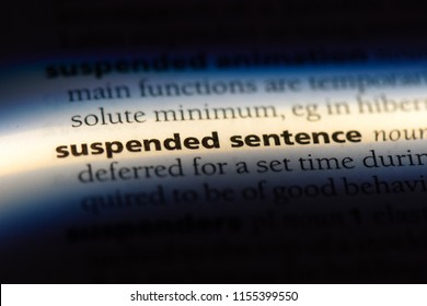 suspend sentence word in a dictionary. suspend sentence concept.