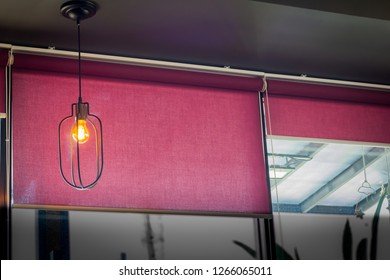 Suspended ceiling lamp with red blind, roller, curtain, roll, shades, shutters.