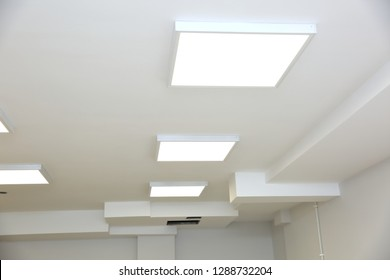 Suspended ceiling with modern LED lighting.