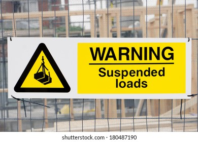 Suspended loads warning sign at a construction site