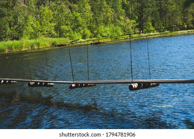 Suspended wooden bridge across the lake. summer day. nature landscape