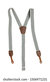 Suspenders isolated. Close-up of green white striped trendy suspenders for jeans of little boy. Fashionable accessories for pants or trousers.