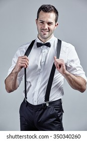 Suspenders isolated over grey