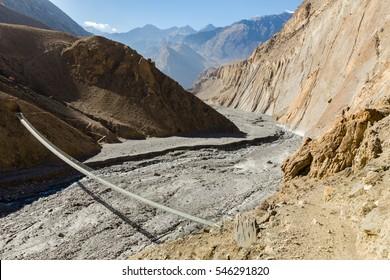 suspension bridge across mountain river, Himalayas, Nepal