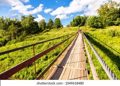 Suspension bridge across the Msta river in Borovichi, Russia