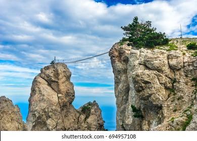 Suspension bridge between rocks on top of Ai-Petri mountain in Crimea