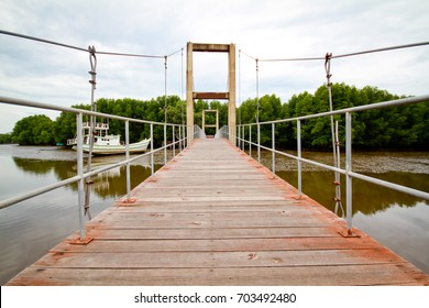 Suspension bridge by sling have Rails is steel and many Wooden floor for walk to the mangrove forest, Thailand