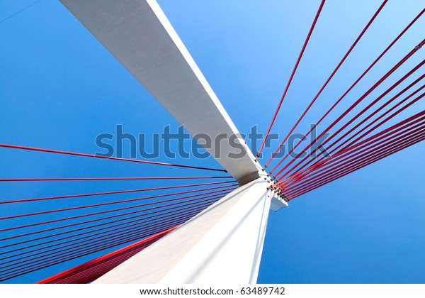 Suspension bridge with cables reaching to the deck of the bridge from the columns