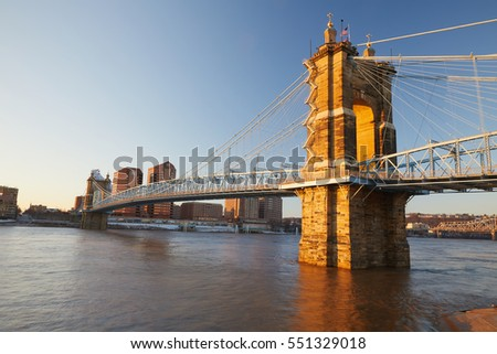 Suspension bridge in Cincinnati Ohio at sunrise.