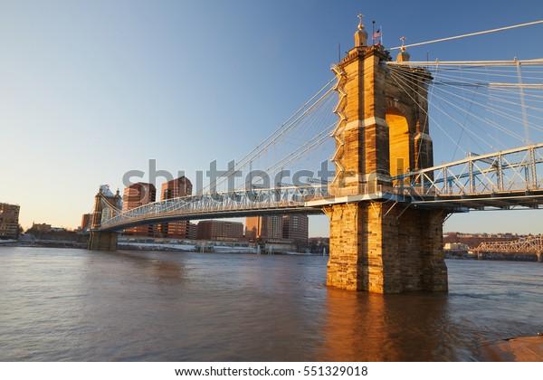 Suspension bridge in Cincinnati Ohio at sunrise.