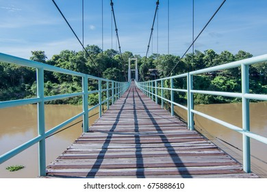 Suspension bridge for crossing the river. At Kaeng Tana Khong Chiam District Ubon Ratchathani, Thailand, with only two concrete pillars. And tied with a wire rope. And then the wooden floor.