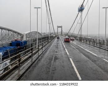 Suspension bridge - driving on a rainy day